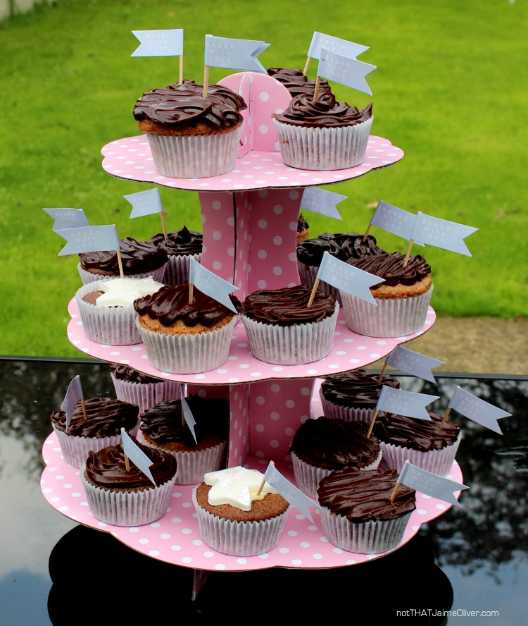 chocolate cup cakes on a pink cake stand