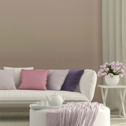 sunny living room with flowers and sofa