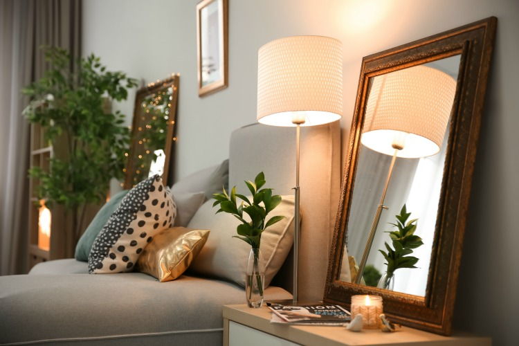 Elegant room interior with mirror on nightstand