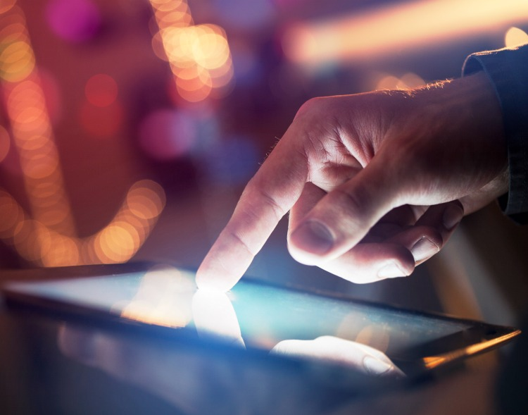 businessman touching digital tablet, closeup