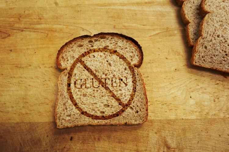 Slice of bread with Gluten text - Gluten Free diet concept