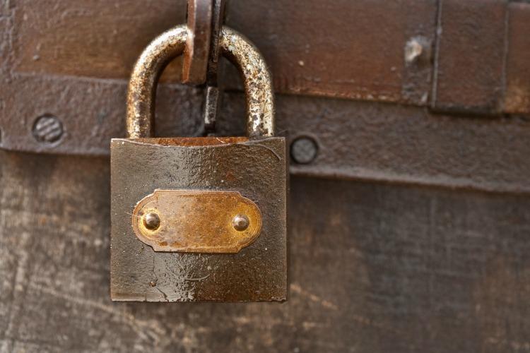 Close up of a rusty vintage padlock
